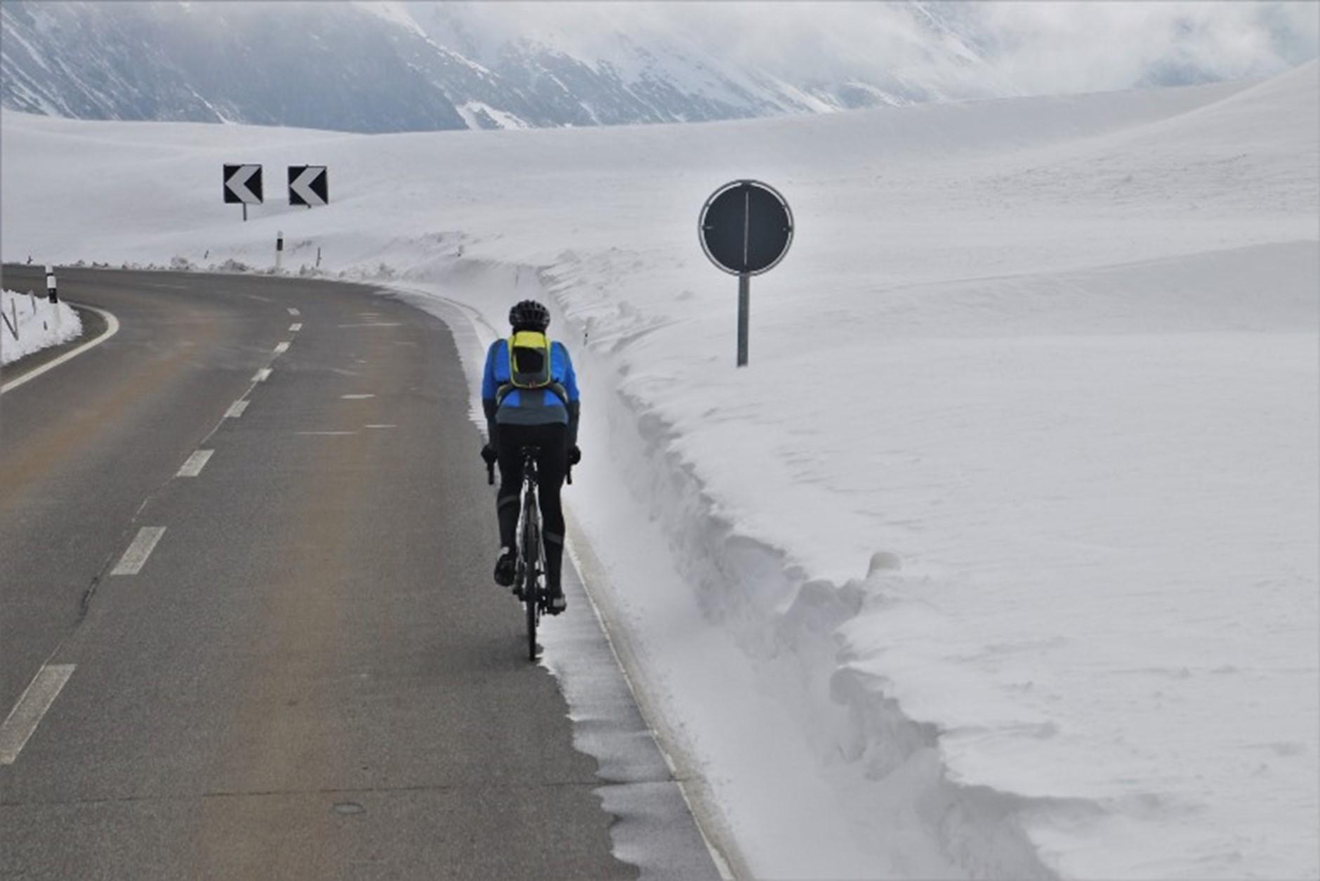 Bike Path bicyclist in winter snow roadway
